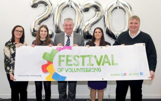 Bid team with festival banner