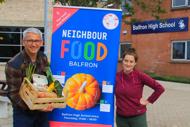 Richard Boddington and Ruth Glasgow with the NeighbourFood sign.