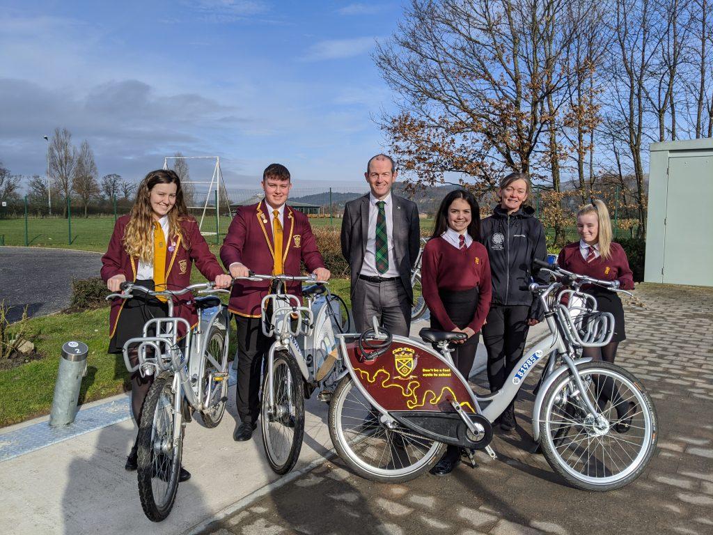 Image shows the new nextbike bike station at St Modan's.  L-R Head girl Brenna Smith, Head Boy Ryan Fitzsimmons, Deputy Head Teacher Barry McGurk, Senay Kurt, Mairi McIntosh of Forth Environment Link and Charlie Gallon.