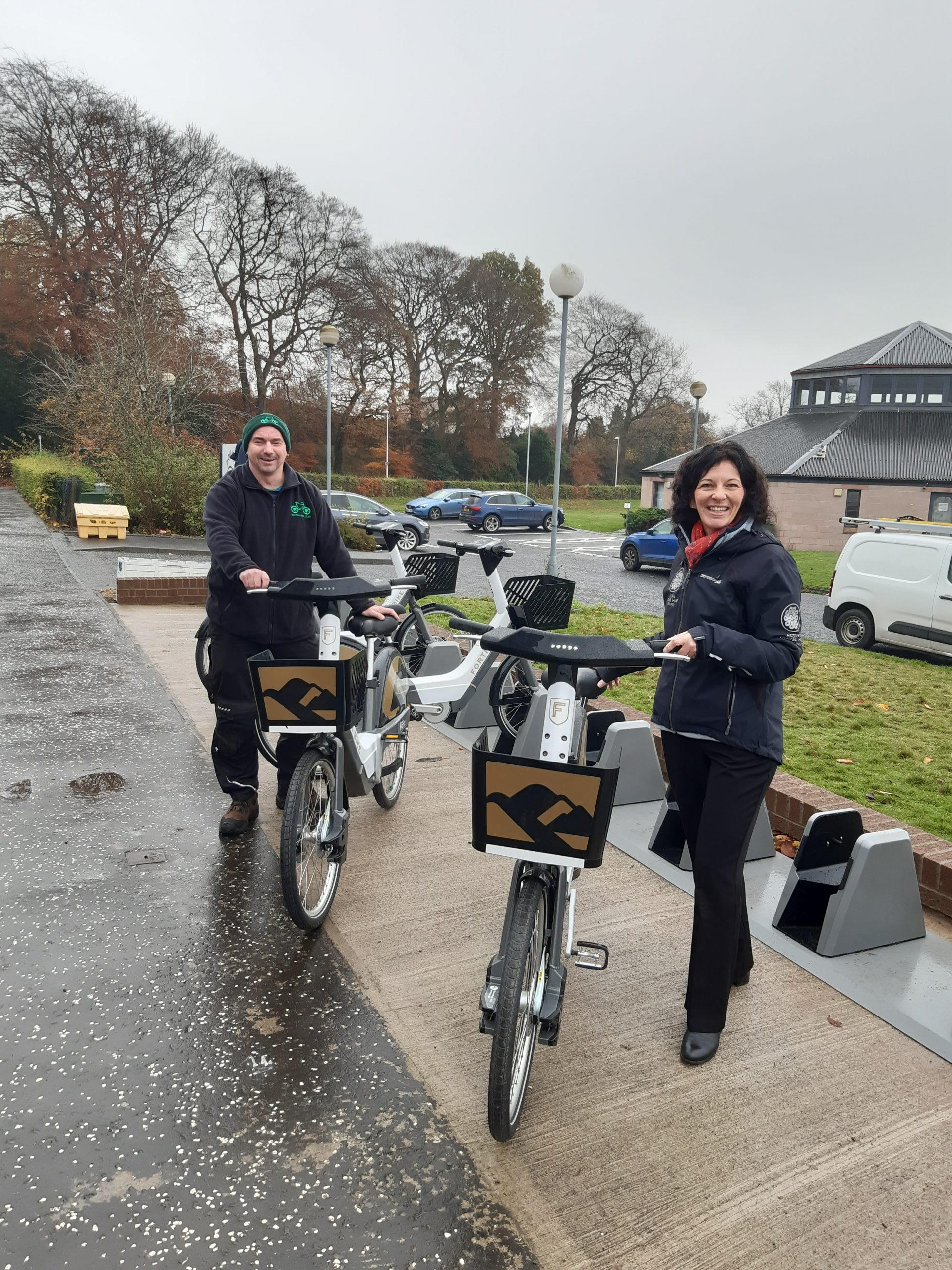 Recyke-a-Bike Contracts Manager Tam Brown helping set up the bikes in Dollar with Forth Environment Link's Active Travel Development Manager Shirley Paterson.